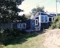 Grey Cottage - Harborside.  Queen bed with bath.  Living room with fireplace, porch, refrigerator, microwave
